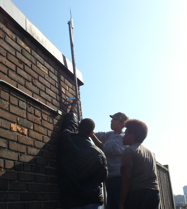 Image of Digital Stewards in Detroit, Michigan, installing hardware.